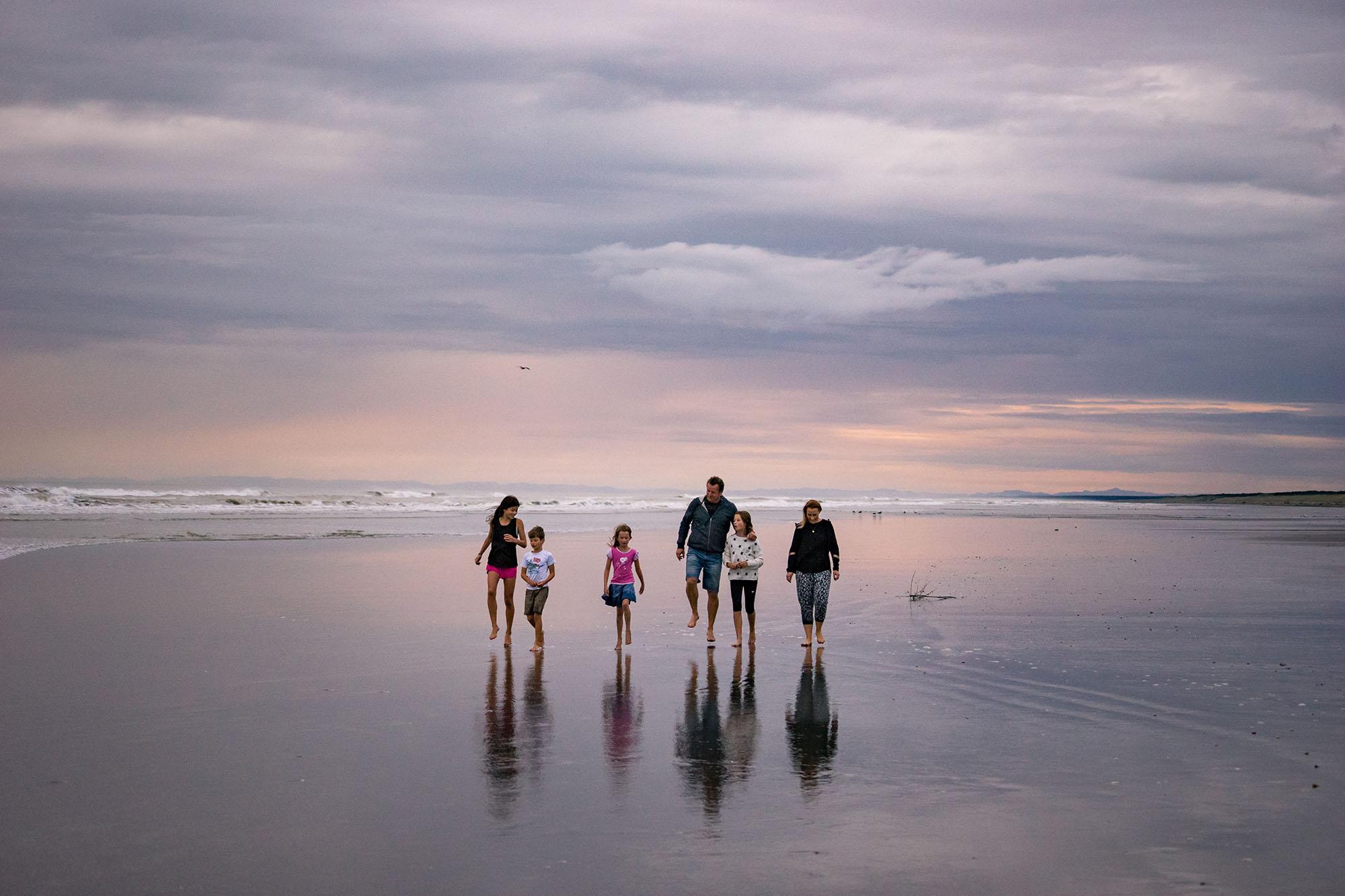 Family walking along Himatangi Beach Manawatu